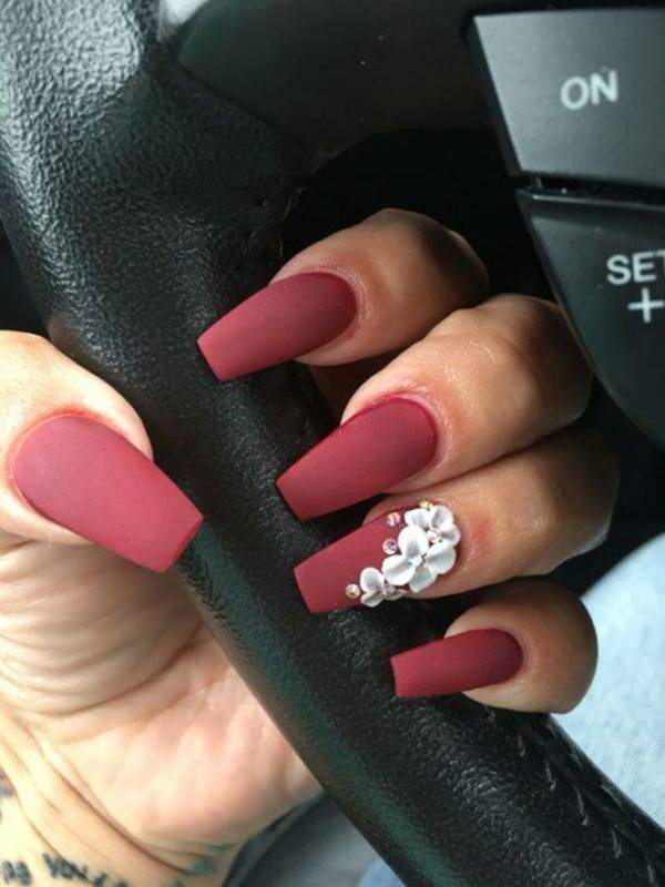 The matte red coffin nail designs. This matte coffin nails with simple  flower design on the ring finger tend to catch the attention of every  trend-seekers. - 58 Creative Coffin Nail Designs For This Season