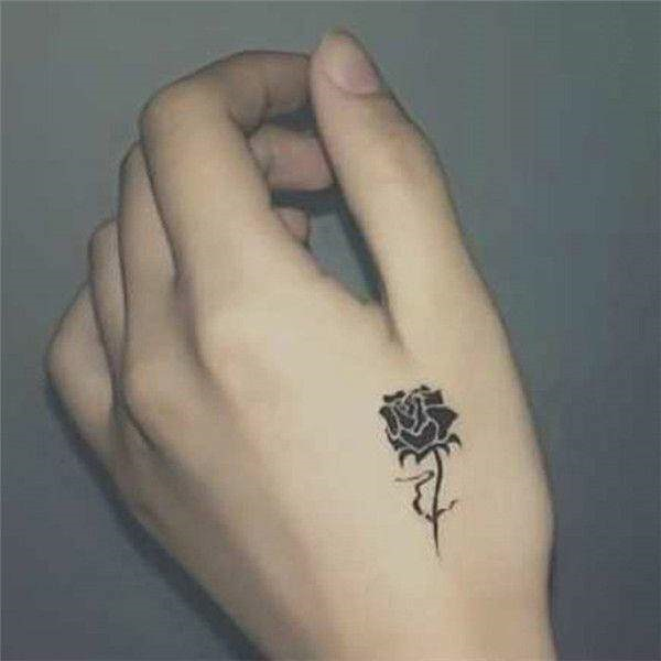 1b7902958dad6 Rose tattoo seems very cute when you make small in your hand like in this  picture.