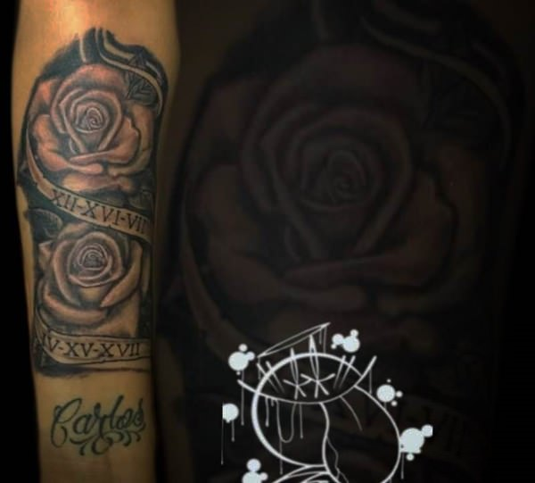 c0e7f4605 Rose is a beautiful flower so, everyone wants them in their body. Here we  have a combination of two roses along with a path with Roman numeral  tattoos.