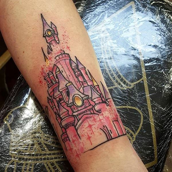 87b4c2a004734 Such a strong resemblance of the place with this Disney castle tattoo. The  palace filled with colors- and only your favorite ones.